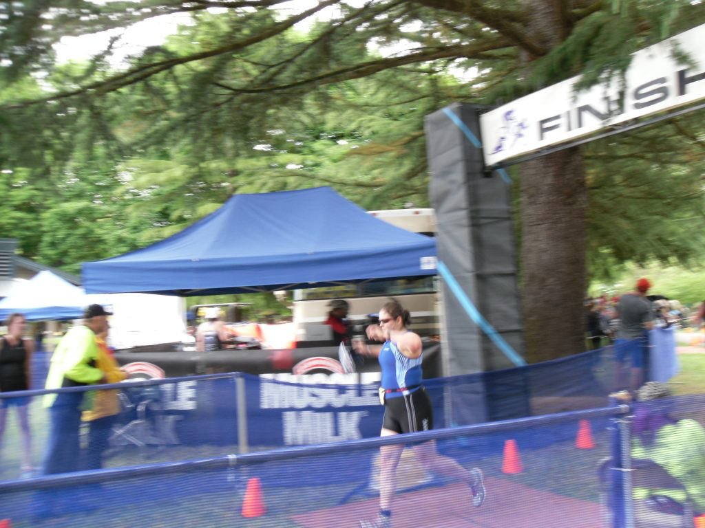 Crossing the finish line at my first official triathlon!