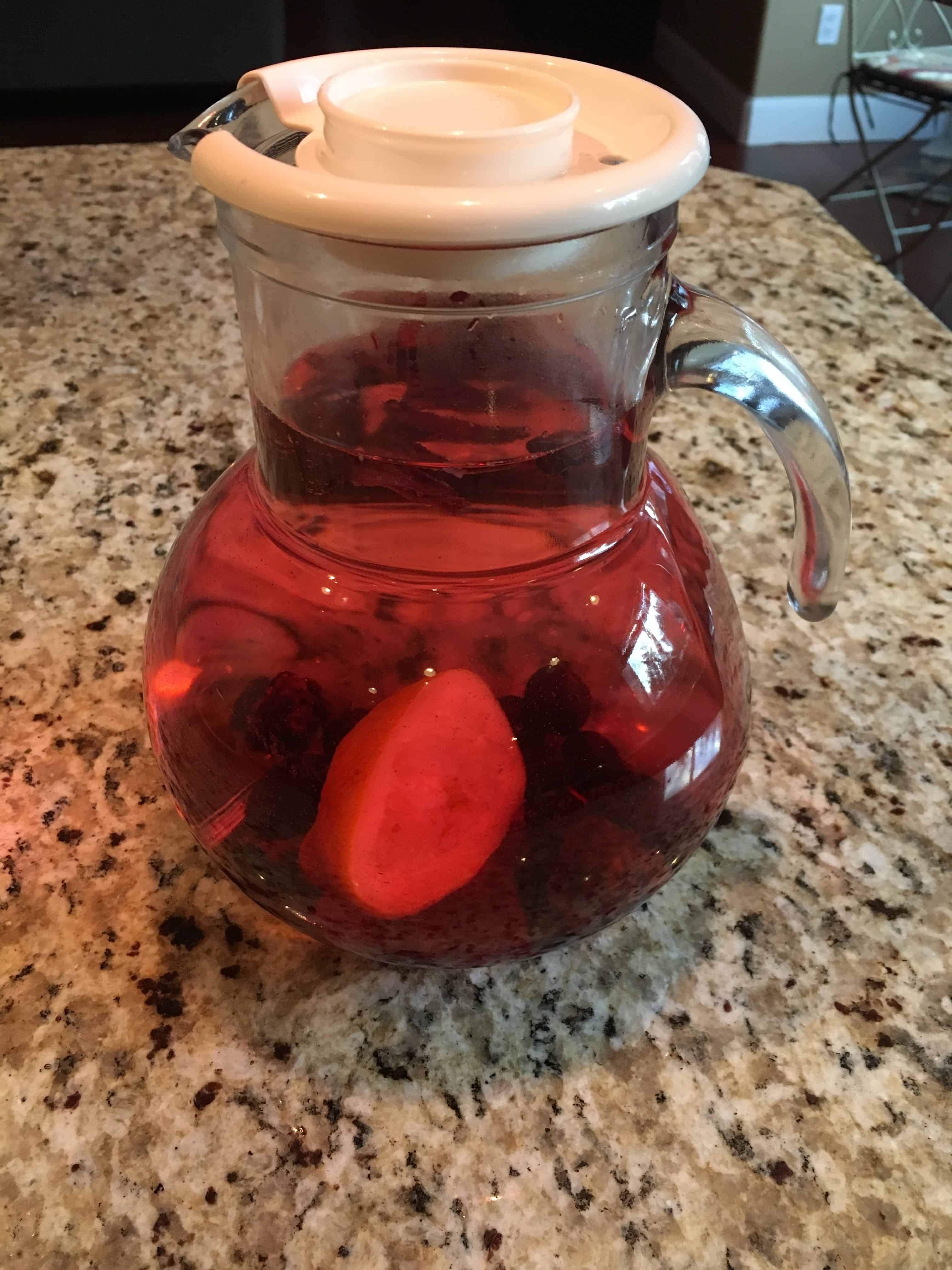 Pitcher of Water Infused with hibiscus flowers, lemons, and berries. https://trimazing.com/
