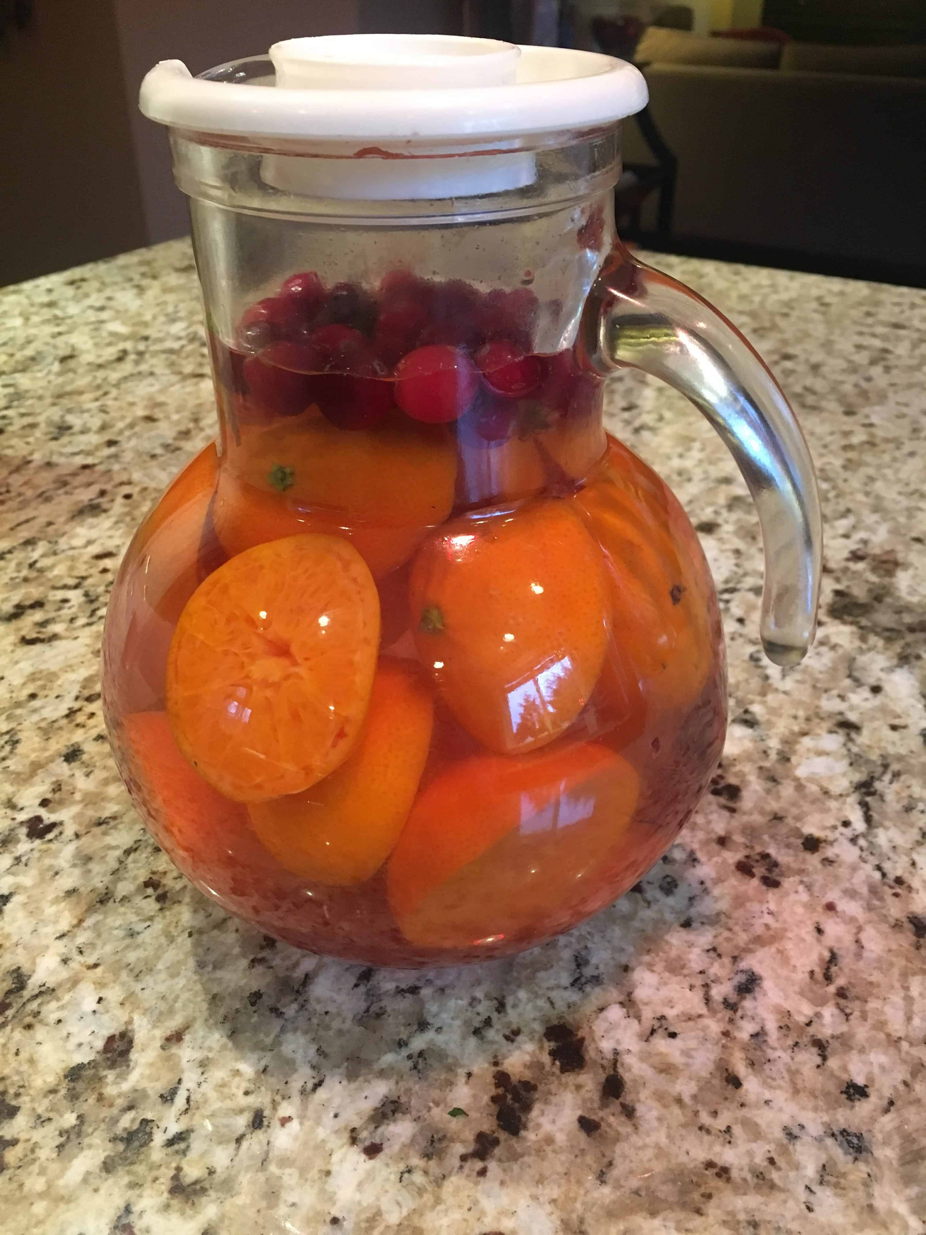 Pitcher of Orange, Cranberry, Cinnamon Stick Infused Water. https://trimazing.com/