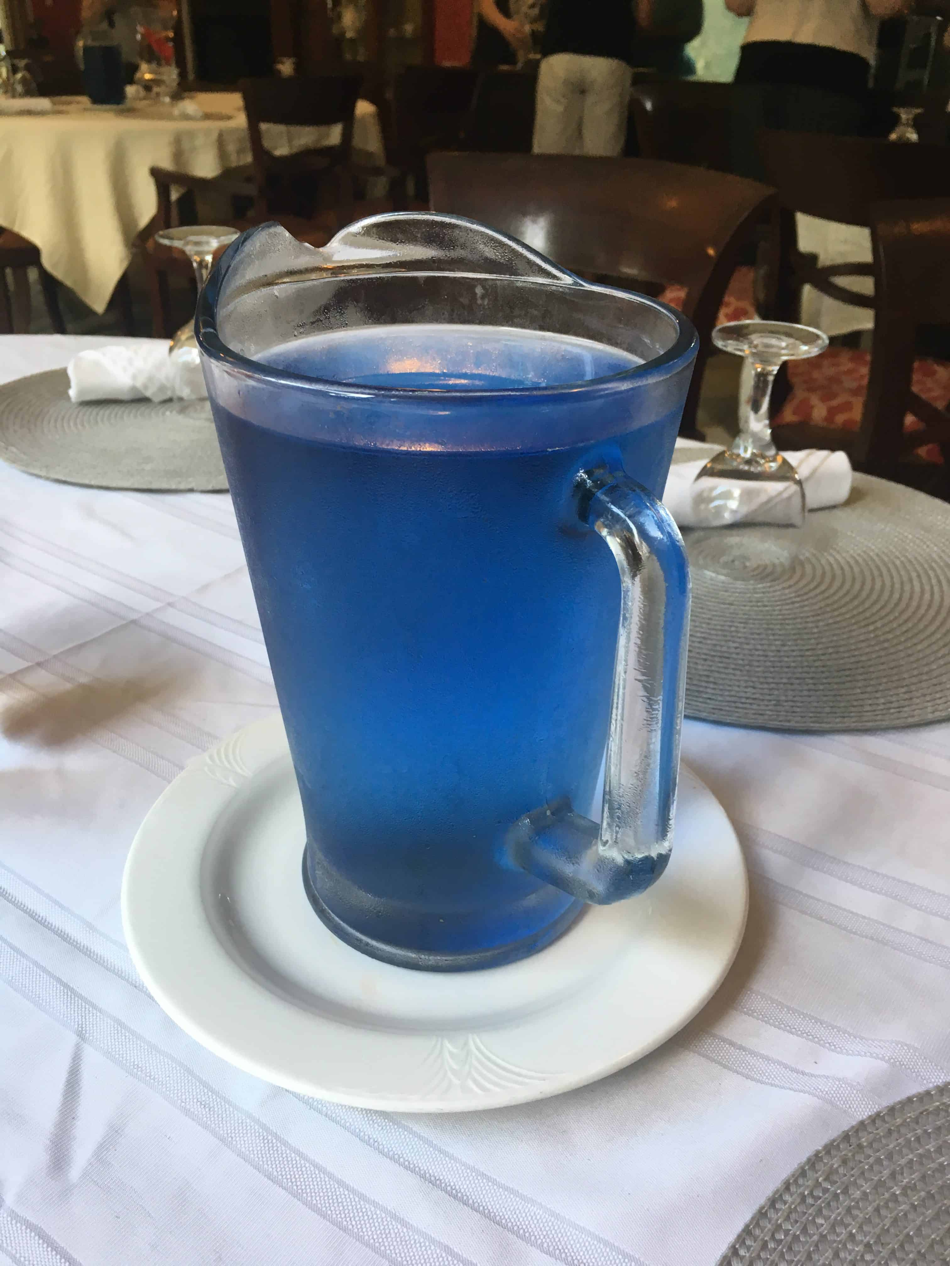 Photo of a Pitcher of Butterfly Pea Flower Water at the Hawaii Island Retreat on the island of Hawaii during the Clean Food Dirty Girl Hawaii Retreat. https://trimazing.com/