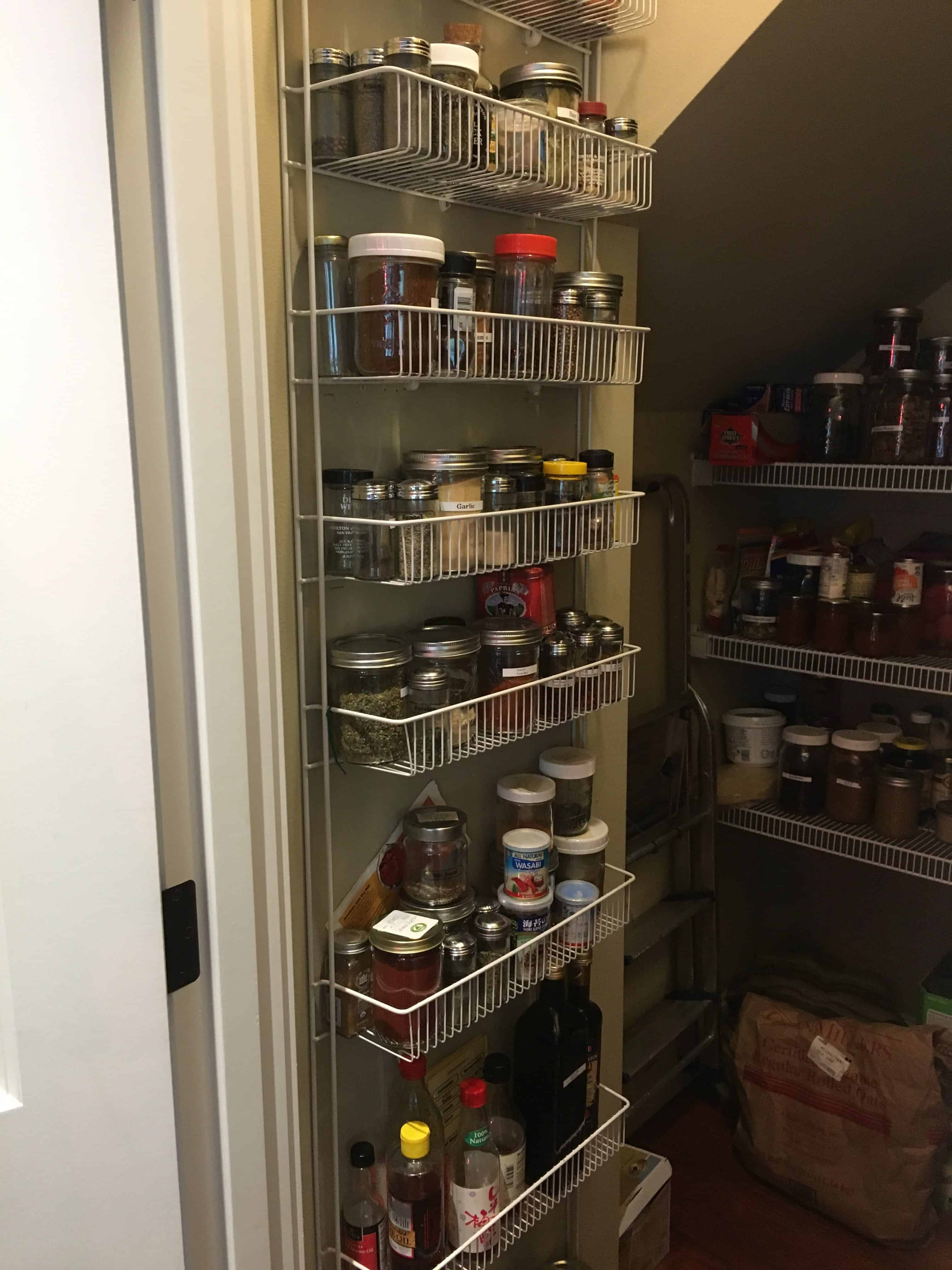 Walk-in pantry with shelves of glass storage jars full of vegan (whole food plant-based) foods https://trimazing.com