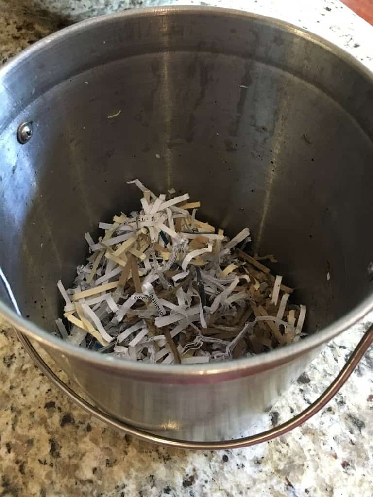 Paper shreds in bottom of compost pail. https://trimazing.com/