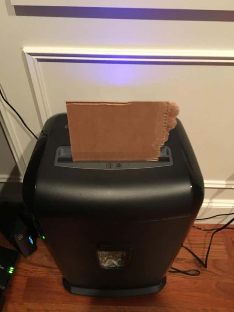 Cardboard feeding into a paper shredder. https://trimazing.com/