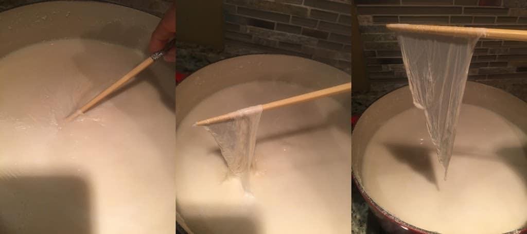 Removing tofu skin (yuba) from surface with a chopstick. https://trimazing.com