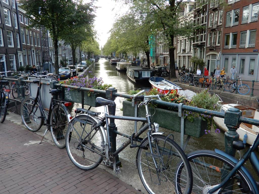 Bicycles parked along the canal in Amsterdam