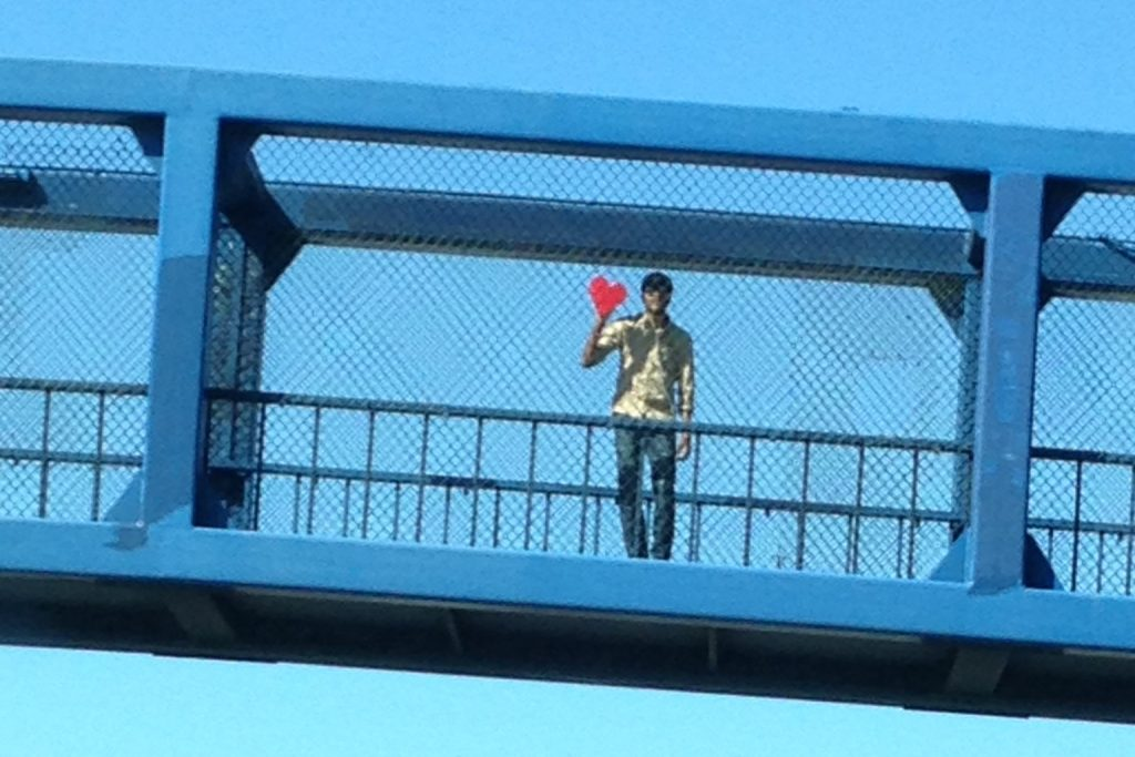 Love guy on 18th Street pedestrian overpass on Highway 101 in San Francisco. Photo by Alan Bell.